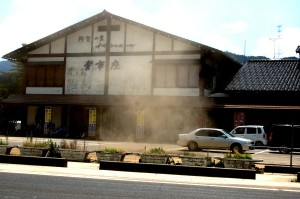Whirlwind creates dust cloud in parking lot.