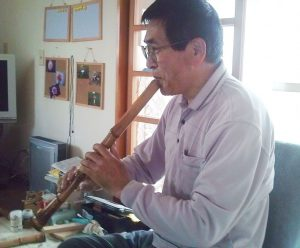 Mr. Murata playing the Shakuhachi