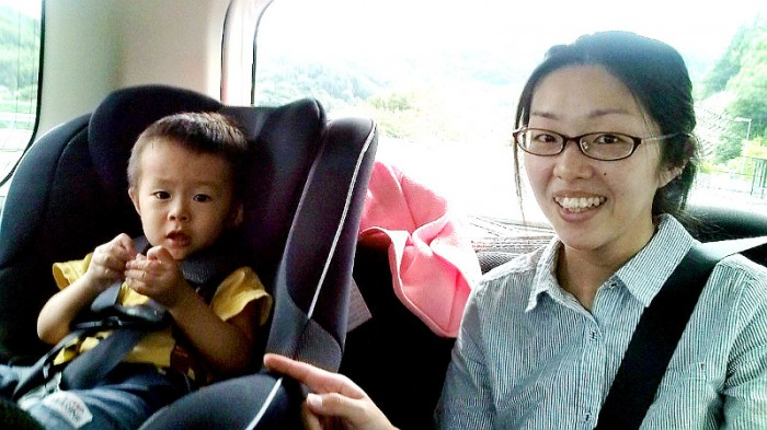 Lady with her son in the back seat of the car that took me to Nagano City on my way back home