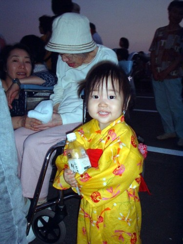 A little girl dressed in a tradition robe called a <i>yukata</i>. This is different, (and certainly less expensive!) than a kimono.