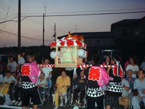 Japanese carrying the Omikoshi