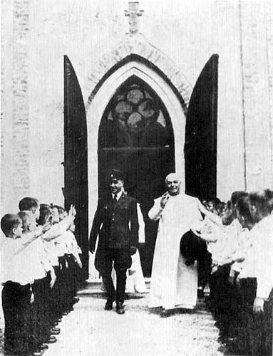 NDH Poglavnik Ante Pavelic, left, with the Papal Emissary Ramiro Marcone.